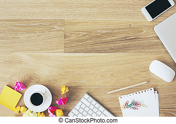 Messy office table - Messy office desktop with coffee cup,...