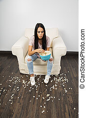 Messy popcorn eater