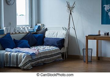 Messy room of single man - Interior of messy room of single...