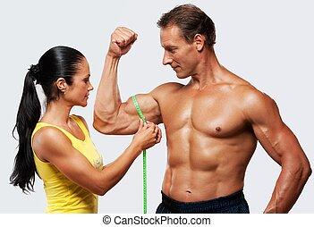 mesurer, athletics's, femme, biceps., homme