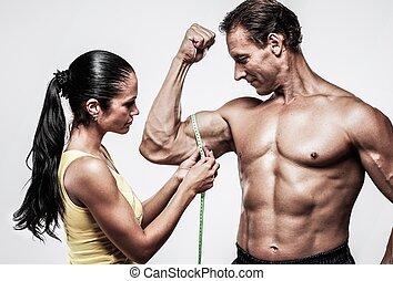 mesurer, biceps, femme, athletic's, homme