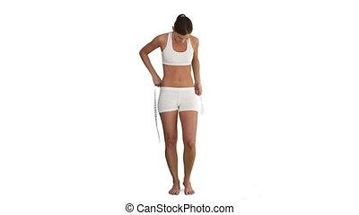 mesurer, femme, elle, brunette, ventre, vêtements de sport