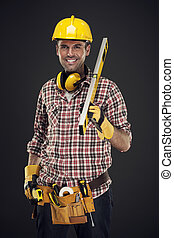 mesurer, sourire, ouvrier construction, tenue