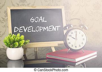 meta, desarrollo, en, pizarra, con, reloj, y, llamarada