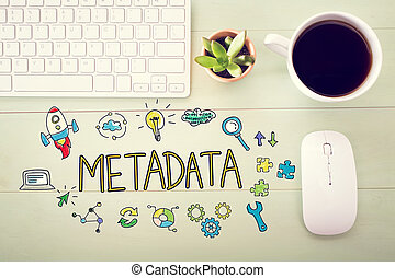 Metadata concept with workstation on a light green wooden...