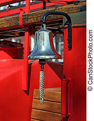 Metal alarm bell on red fire truck