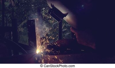 Metal arc welding in workshop
