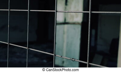 Metal bars against dark background dolly shot