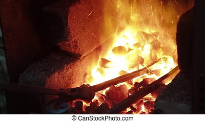 metal bars in a forge furnace