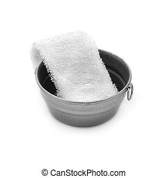 Metal basin and white towel on a white background.