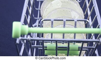 Metal basket with Bitcoins - In a miniature metal basket...