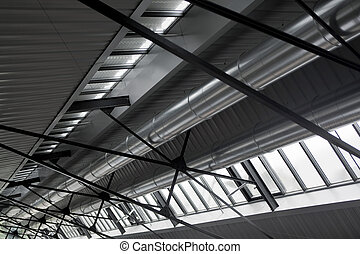 Metal beams and evacuation ducts