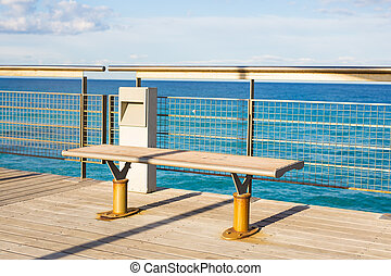 Metal bench in front of the sea