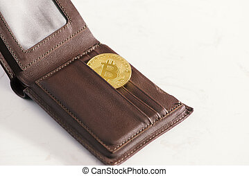 Metal bitcoins in brown leather wallet. Bitcoin - modern virtual