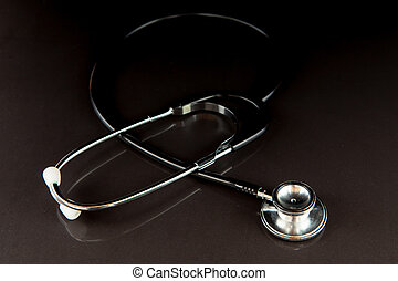 Metal black stethoscope in the dark