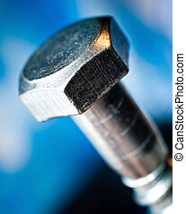 metal bolt heads with blue blur background