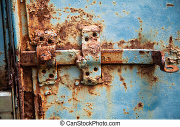 Metal bolt on the gate of old