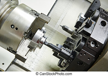 metal boring process on machine tool - drilling hole or...
