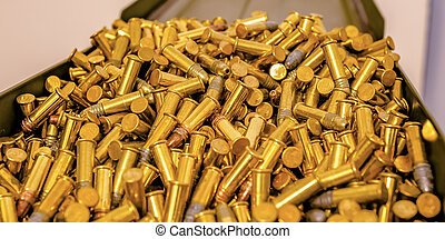 Metal box filled with cylindrical golden bullets. Close up...