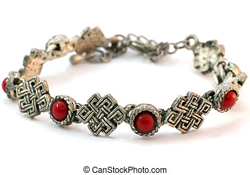 Metal bracelet with corals on white backgriund