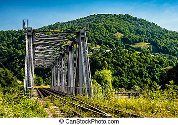 metal bridge in Carpathian countryside - old metal rail road...