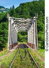 metal bridge in mountains - old white rusty metal rail road...