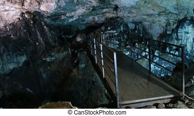 bridge inside the underground cave - metal bridge inside the...