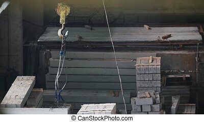 Metal cables on the hook are fixed for the operation of the...