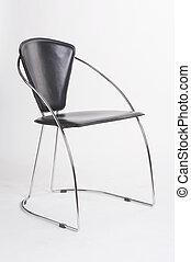 black metal chair on white background - schwarzer Metallstuhl vor weissem Hintergrund