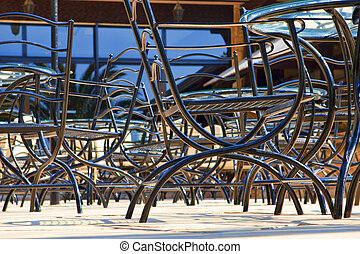 Metal chairs in street cafe.