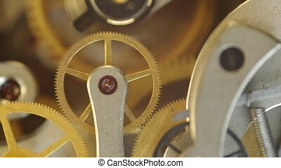 Metal cogwheels inside clockwork