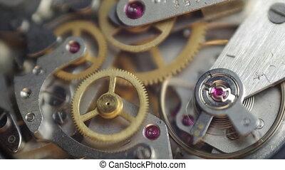 Metal cogwheels inside clockwork chronograph. Concept ...