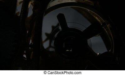 Metal cogwheels inside clockwork. Close up