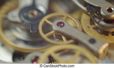 Metal cogwheels inside clockwork.