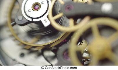 Metal cogwheels inside clockwork. Concept Eternity, Teamwork...