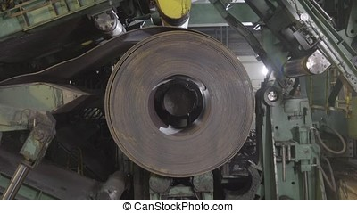 Metal coils machine. The machine at the factory. Machine for rolling steel sheet in warehouse, Cold rolled steel coil