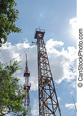 metal communication tower against the sky