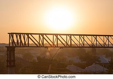 metal construction at sunset