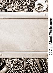 metal construction hardware tool on metal texture