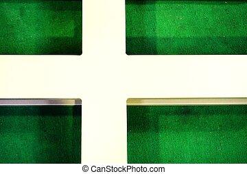 metal cross on green carpet