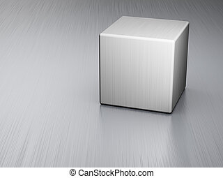 Metal cube on brushed steel plate