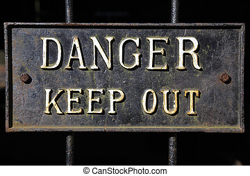 metal danger keep out sign on railings