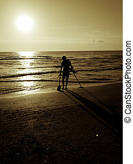 metal detecting at the evening beach