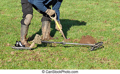 Metal Detecting - Digging a hole to retrieve signal metal ...