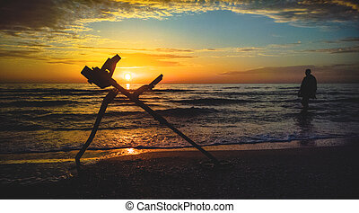 metal detector at the evening beach