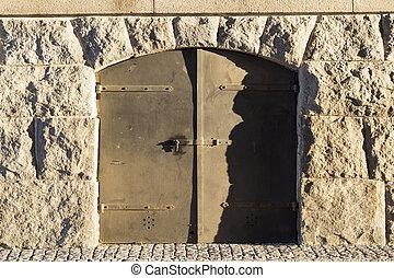 Metal Door in Stone Wall