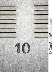 Metal door with number ten