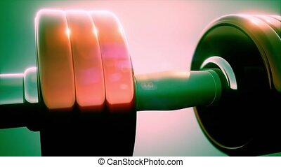 metal dumbbell rotate on colored background