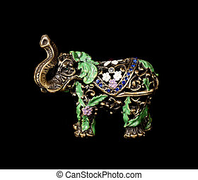Metal elephant with crystals on the black background (souvenir)