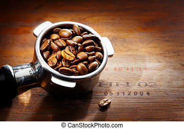 Metal espresso filter with coffee beans